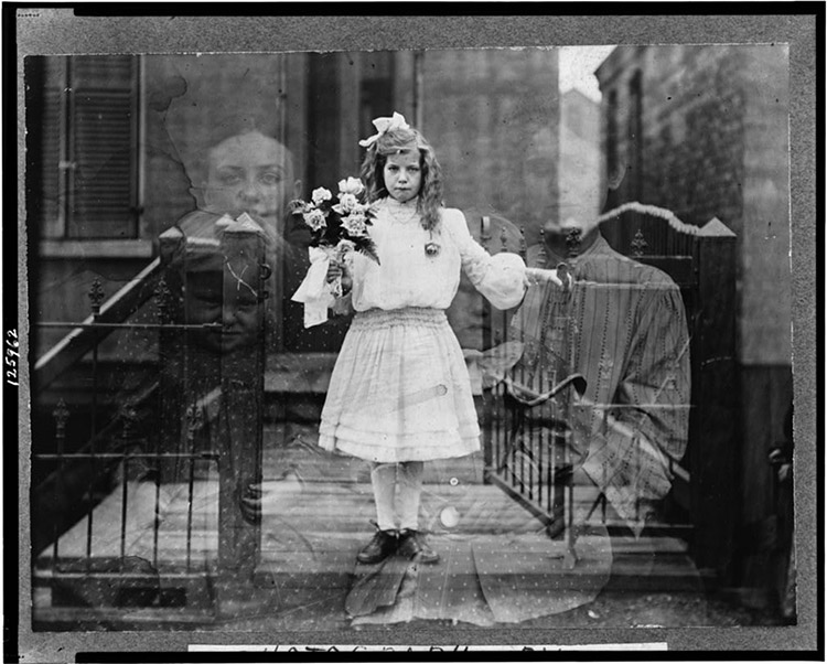 "Double exposure ""spirit"" photograph of girl standing, holding flowers, surrounded by spectral figures of three people, 1905 - Photograph by G.S. Smallwood, Chicago, Ill."